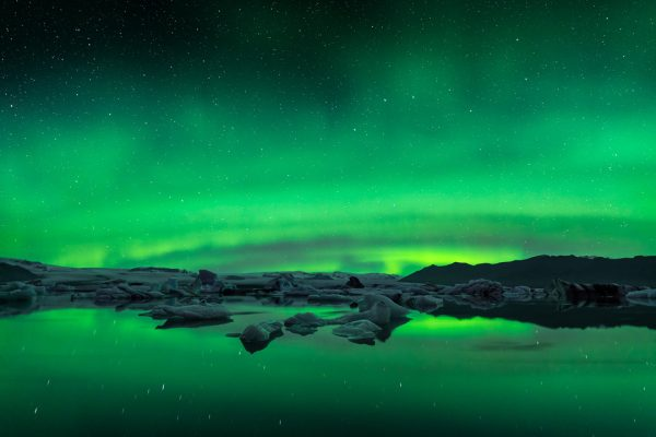 Beautiful Aurora activity above the glacier lagoon in Iceland