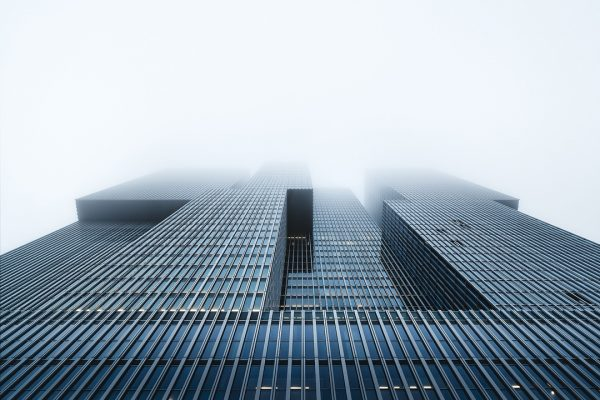 'The Rotterdam' captured during some high fog on an early morning. By using the fog the depth of the image is exaggerated. Looking up one of the iconic buildings of Rotterdam.